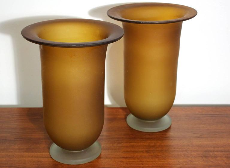 Large pair of Murano glass vases with wide flaring rim. Circa 1970s. Small imperfection on top edge as pictured. Appears to be a manufacturing flaw from when the glass was made and original to the vase. In excellent vintage condition. One vase is