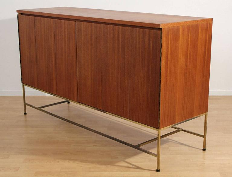 Excellent Paul McCobb designed Credenza for Calvin Furniture, circa 1950s. Iconic style and design. Base is brass with a wonderful patina. Mahogany wood has been refinished and hand oiled to bring out the beauty of the wood. This credenza is a