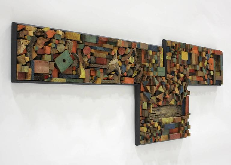 Great handcrafted artisan wood wall abstract sculpture/construction. This is a one of a kind wall hanging and is signed by the artist. Dated 1973. Each piece is hand cut and painted to form the awesome design. Measures: 85
