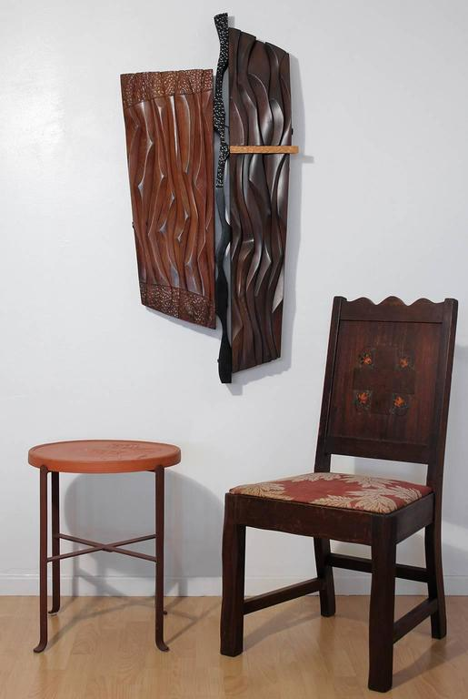 Abstract redwood and mahogany carved wood wall hanging sculpture, circa 1960s. Label on reverse as pictured. Titled