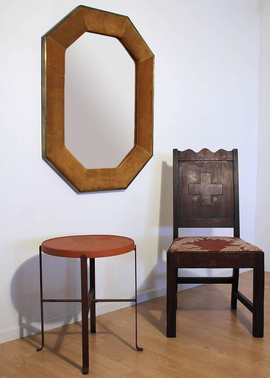 Suede leather and brass octagonal shaped mirror by Widdicomb and sold through John Stuart. Brass has been purposefully left in unpolished original condition showing patina.