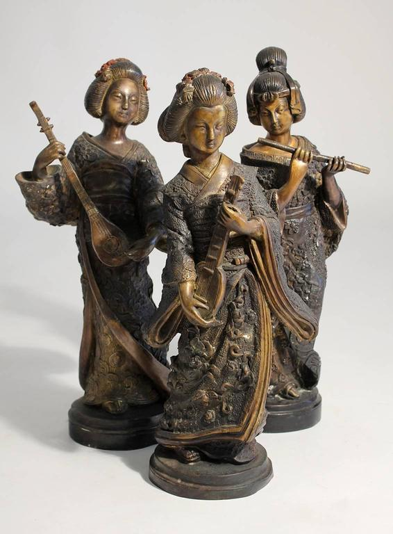 Beautiful set of three Japanese cast bronze and cold paint art sculptures. Great detail and wonderful patina. In excellent shape and display well. 