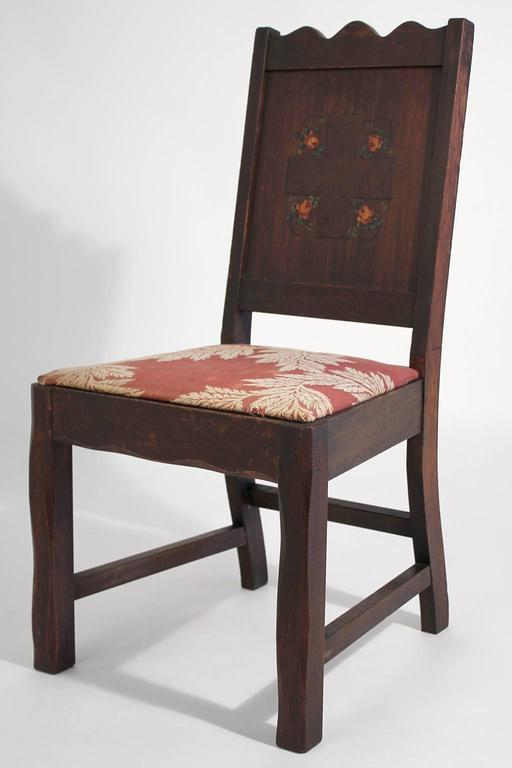 Tough to find original antique oak Arts & Crafts hand painted Monterey/Mission accent chair. I am pretty sure this was from a mission or church. Has an engraved cross on the back with hand painted floral accents. Made of solid oak. Has old