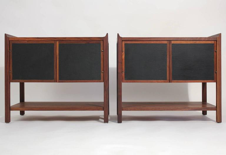 Beautiful pair of Dillingham walnut end tables or nightstands. Front doors open up for great storage. Lower shelf can be used for storage also. Front door panels have a black material accent that contrasts the American Walnut wood. Need tables have