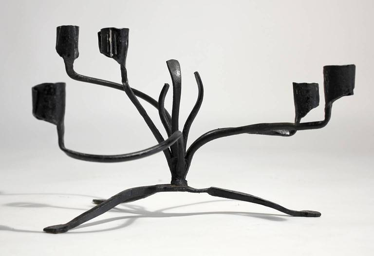 Unique sculptural Brutalist hang forged iron tabletop candelabra by renown California designer/craftsman C. Carl Jennings. Excellent vintage original condition with some residual wax and general age related wear from use. Signed.