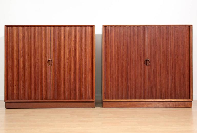 Great pair of Danish teak tambour chests or buffets by Peter Hvidt & Orla Mølgaard Nielsen. Chests feature two interior adjustable shelves. Doors open and close as they should. In excellent condition with no issues. These have been hand oiled and