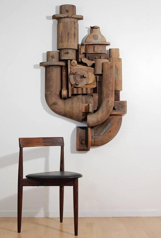 Large abstract wood wall sculpture relief made from antique Industrial foundry wood molds. Very well executed composition with overall weathered finish as pictured, circa 1960s.