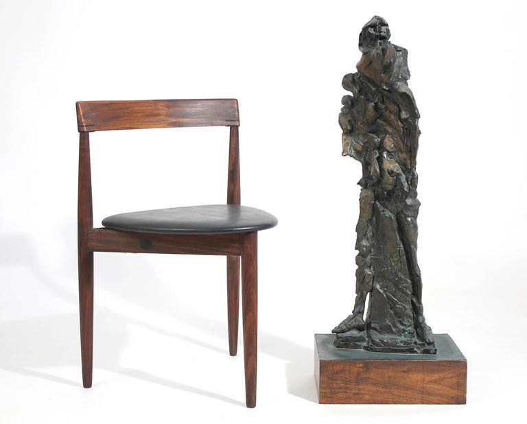Large and very well executed cast bronze abstract Brutalist figural sculpture mounted on wood base with copper clad top. Artist unknown, circa 1960s.