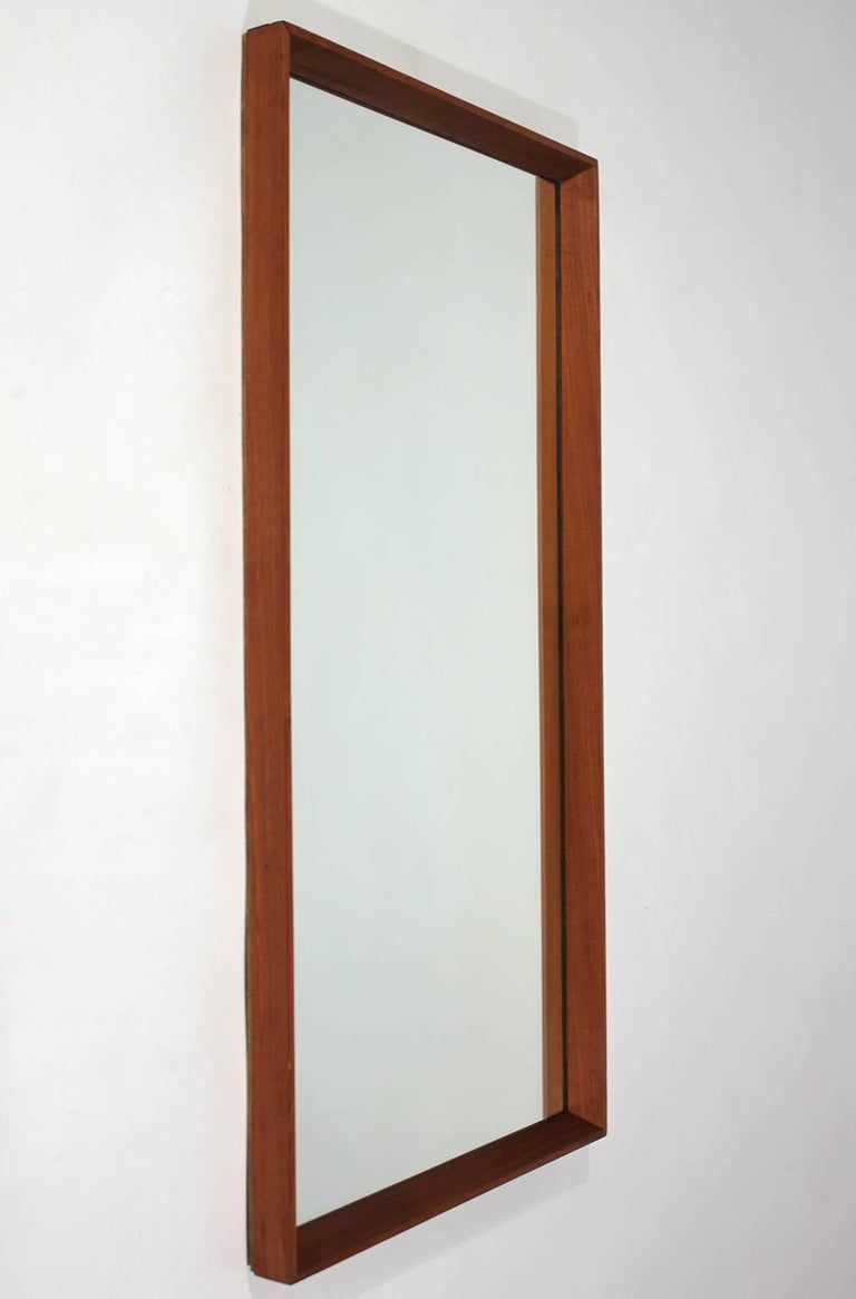 Beautiful modernist Danish teak mirror. Solid teak frame and in excellent condition.