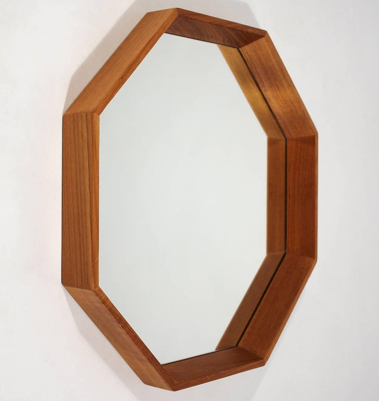 Great modernist Danish teak Octagon mirror designed by M.M. Spejle. In excellent shape with no issues. Mirror has no chips, no cracks and no scratches. Frame has been hand oiled and has wonderful grain and color.