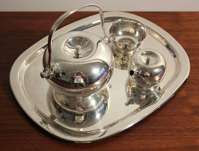 Beautiful modernist Dansk silver plate tea set designed by Vivianna Torun, circa 1960s. Comes with the tea pot, tray, creamer and sugar. Very rare to find complete. In excellent shape with no dents and the silver plate is in great shape.