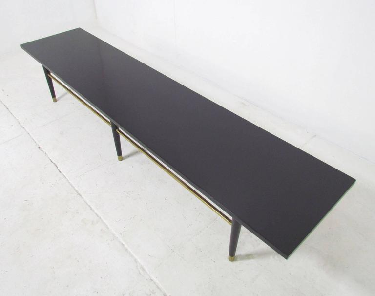 Mid Century Coffee Table With Brass Stretchers In Manner