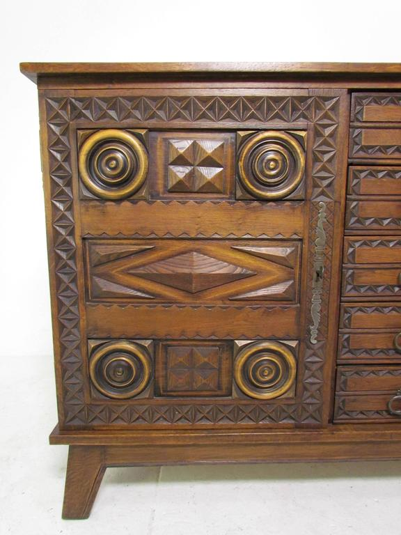 Mexican modernist chip carved and decorated oak credenza