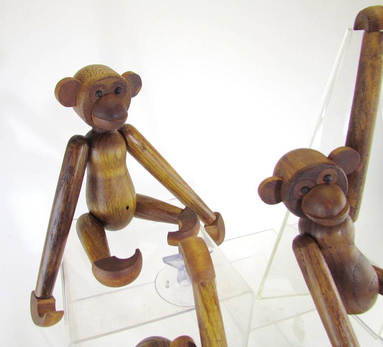 Mid-Century Modern Grouping of Teak Monkey Toys 6