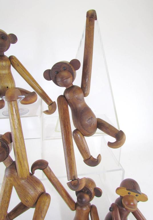 Mid-Century Modern Grouping of Teak Monkey Toys 8