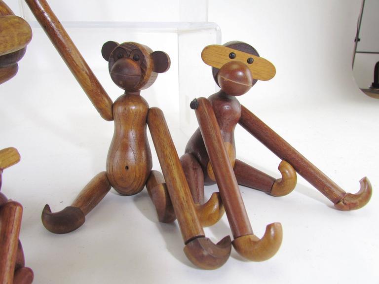 Mid-Century Modern Grouping of Teak Monkey Toys 4
