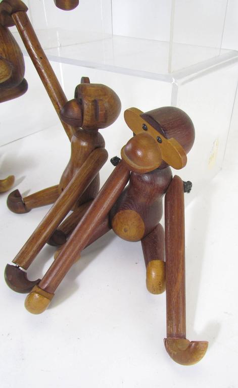 Mid-Century Modern Grouping of Teak Monkey Toys 5