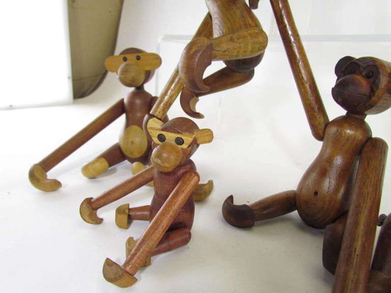 Mid-Century Modern Grouping of Teak Monkey Toys 3