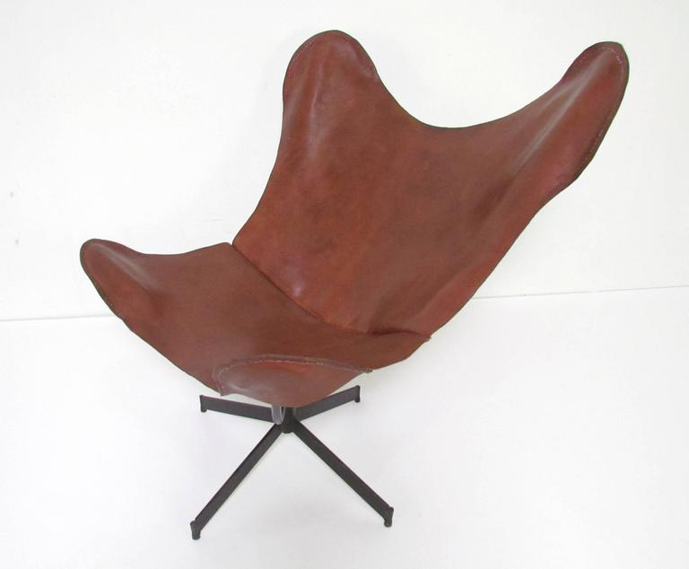 Swivel lounge chair with leather sling for Leathercrafter New York, attributed to William Katavolos.