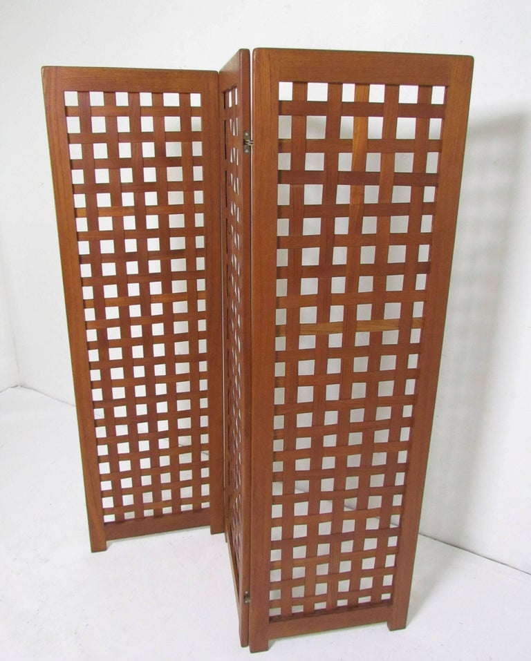 Teak three-panel basket weave screen circa 1970s, marked made in Denmark.