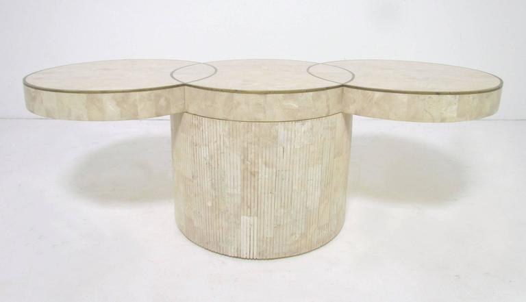 Cocktail Table With Tesated Fossil Stone Top Of Three Conjoined Disks Inlaid A Brass Trim