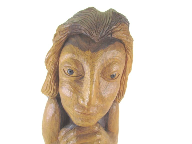 "Carved wood sculpture of a female form titled ""Miss Num' by Diane Derrick, circa 1973.