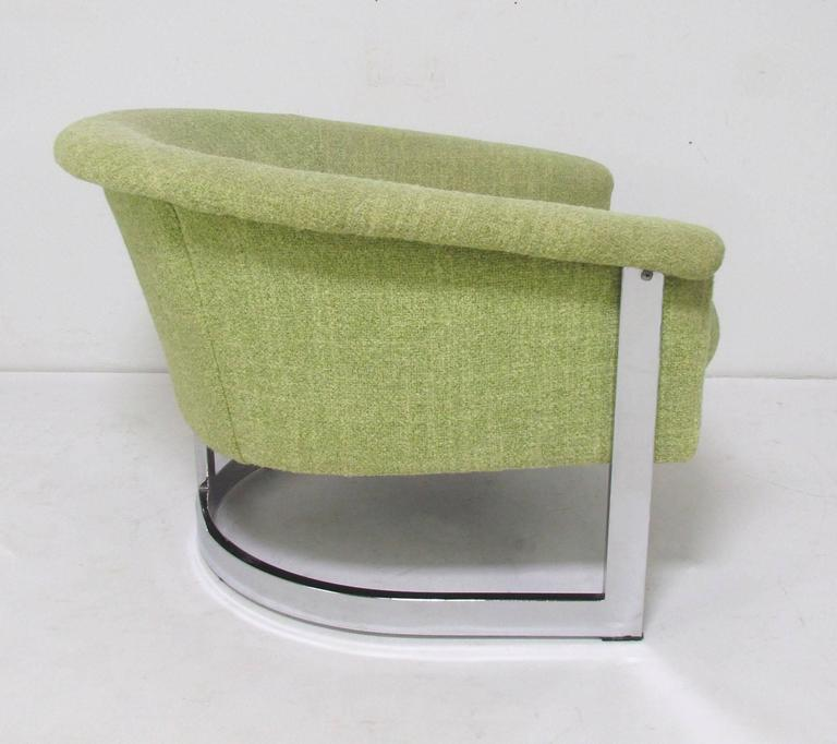 """Barrel form lounge armchair with chrome frame and flared arms, in the manner of Milo Baughman, marked """"Made in Italy,"""" circa 1970s."""