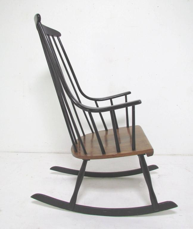 Danish Modern rocking chair designed by Lena Larsson, Sweden, circa late 1950s-early 1960s. Original black lacquer finish with contrasting ash seat. This design is often mistakenly attributed to Ilmari Tapiovaara. Very faint maker's mark on
