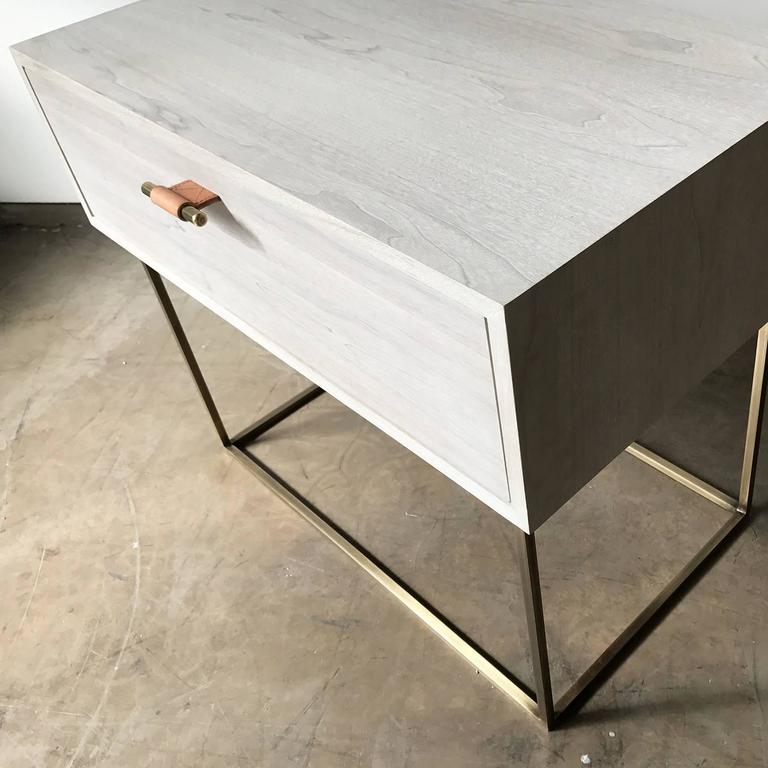 The Kerry side table by Thomas Hayes Studio features a custom wood case with a solid steel or brass base. The drawers are made with the highest quality soft-close mechanisms that open with our leather wrapped brass pulls. The Kerry is available in a