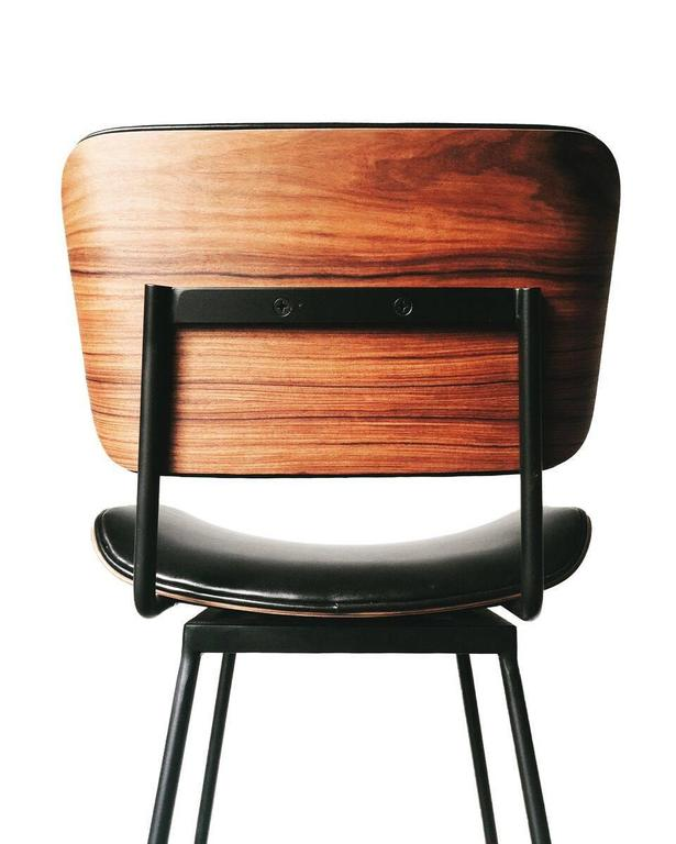 A custom order, Limited Edition bar stool featuring vintage bent Rosewood back and seat on a contemporary linear flat-black finished steel base. The curved rosewood back and seat were sourced in Brazil and are available while inventory allows. Two