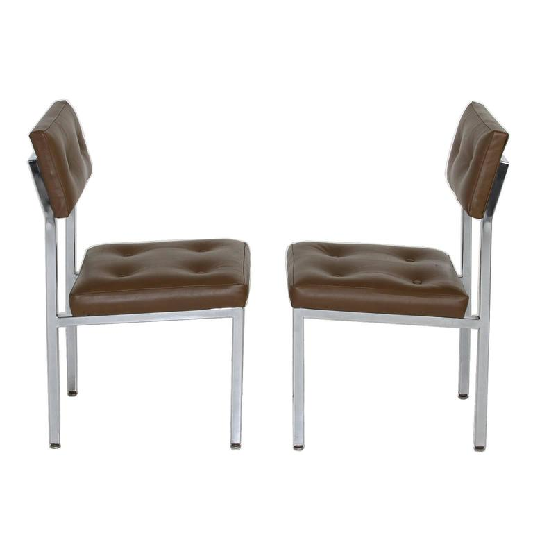 Set of olive green tufted leather and chrome dining chairs at 1stdibs