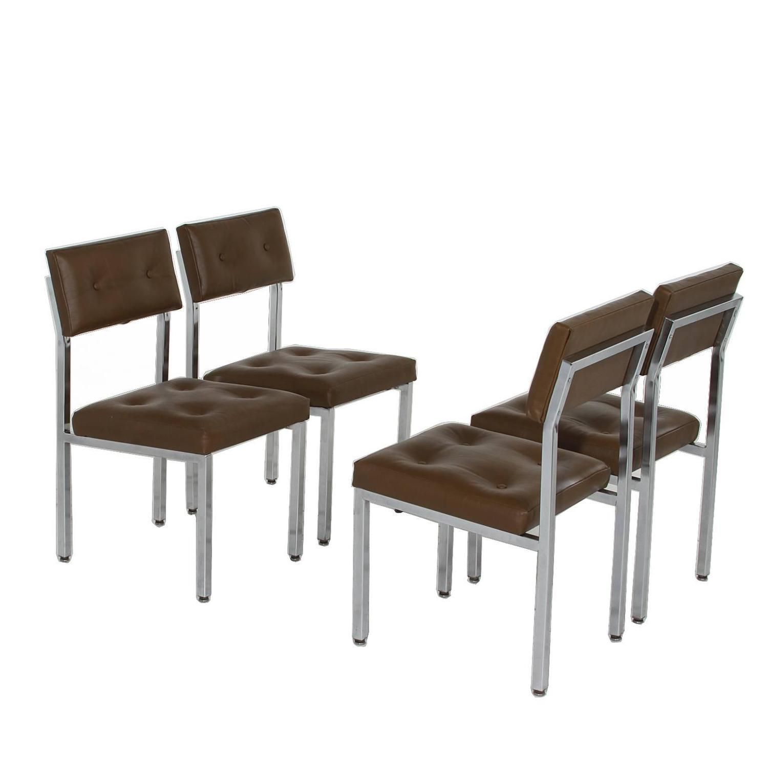 Set of olive green tufted leather and chrome dining chairs for Tufted leather dining room chairs