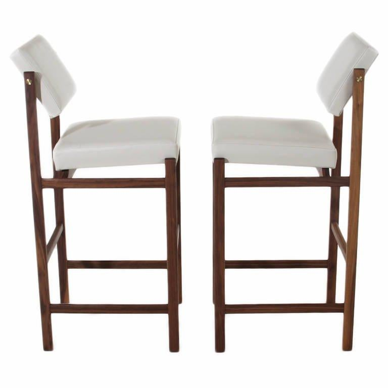 A custom, elegant solid wood stool available in a variety of woods and finishes with solid wood frame, pivoting back, and upholstered seat by Thomas Hayes Studio. The angle of the back creates good lumbar support. The frames are accented with solid