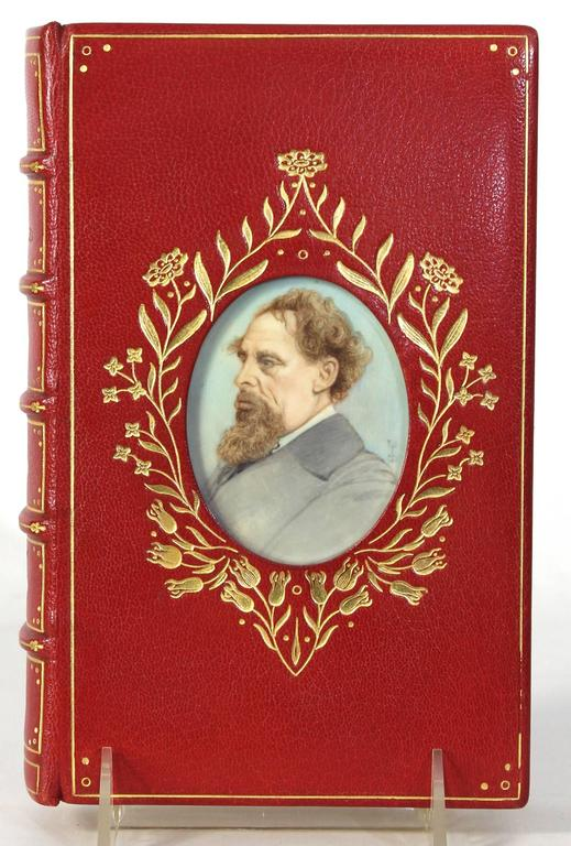 A spectacular first edition David Copperfield by Charles Dickens in fine red leather cosway binding inset with hand-painted portrait miniature of the author.