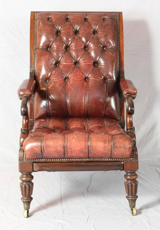 An Elegant English William IV Articulated Mahogany Library Chair Covered In  Mellow Old Red Buttoned Leather