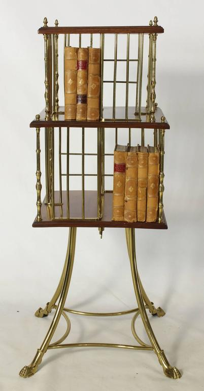 An English Edwardian brass and mahogany revolving bookstand.