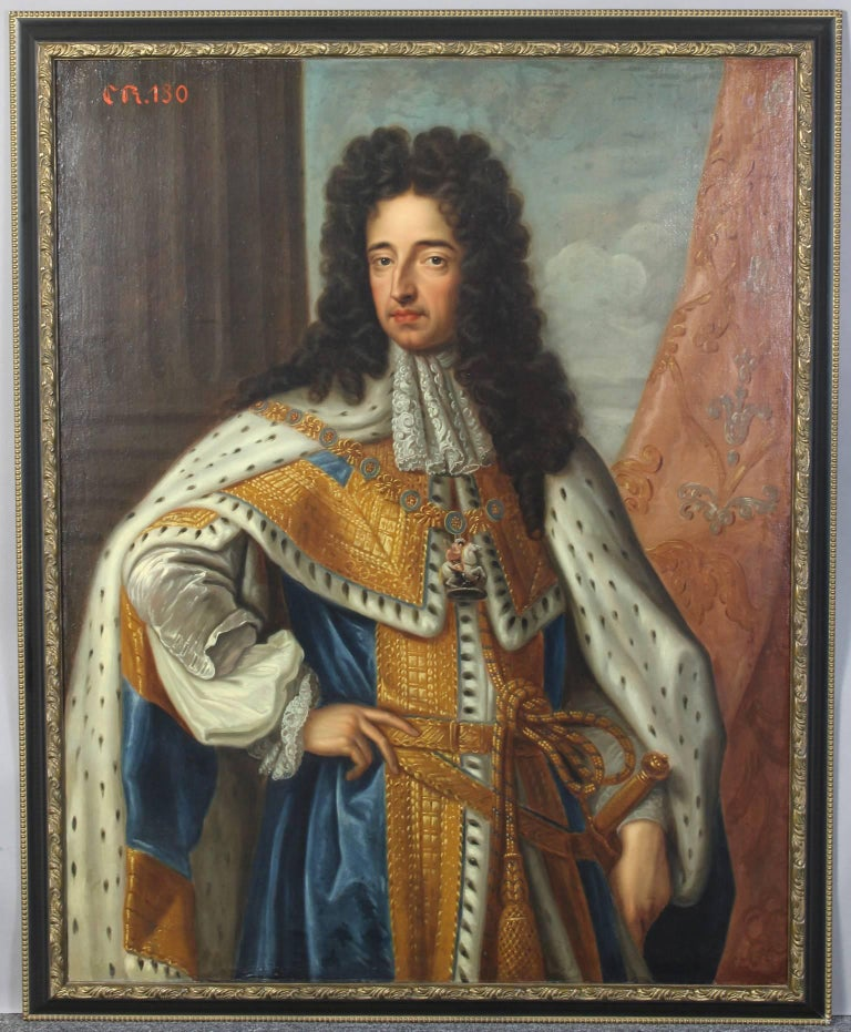 A large and dramatic oil on canvas portrait of a standing King Charles II (1630-1685) wearing the Robes of the Garter in later ebony and gilt frame.