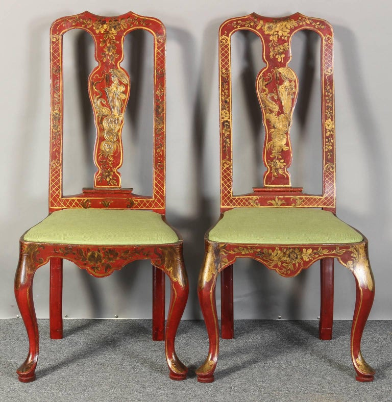 A pair of Italian scarlet colored mid-20th century Queen Anne style chinoiserie side chairs in with Fine gilt decoration and green linen seat cushion.
