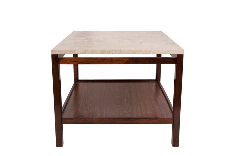 A modernist, circa 1960s side table, with marble top on rectilinear base in Brazilian jacarandá wood with lower shelf. This table remains in very good vintage condition, consistent with age and use.