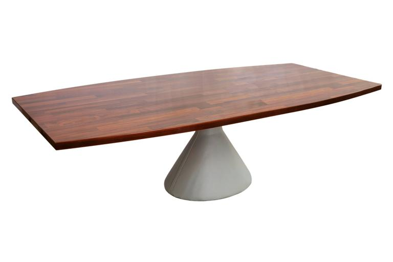 The 'Guaruja' dining table by architect and designer Jorge Zalszupin, including a  rounded top in Brazilian jacarandá and raised on conical pedestal base with gray leather cover. Excellent condition and leather base recently reupholstered.