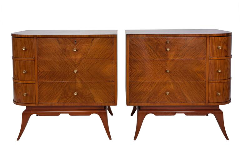 A pair of Giuseppe Scapinelli dressers, produced circa 1960s, crafted of Brazilian wood, with asymmetrical bookmatched front, either with single rounded corners and raised on tapered legs. May be separated as nightstand commodes. Very good vintage
