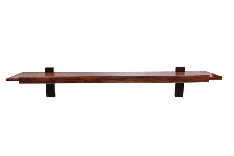 A wall-mount console by designer Sergio Rodrigues, produced circa 1960s, of linear form, crafted of rich Brazilian jacaranda. Very good vintage condition.  10906
