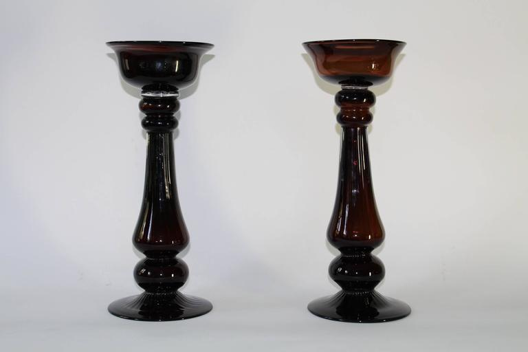 """Pair of Mid-Century Modern, circa 1950s-1960s candlesticks, baluster form in hand blown brown colored glass. Each may accommodate a single candle 4"""" diameter. Very good vintage condition, no signs of wear.  11096"""