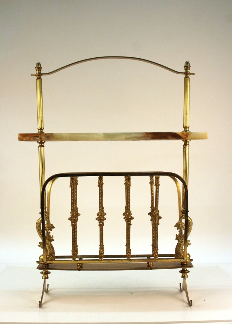 Mid-Century magazine rack made in Italy during the 1950s with brass and onyx.
