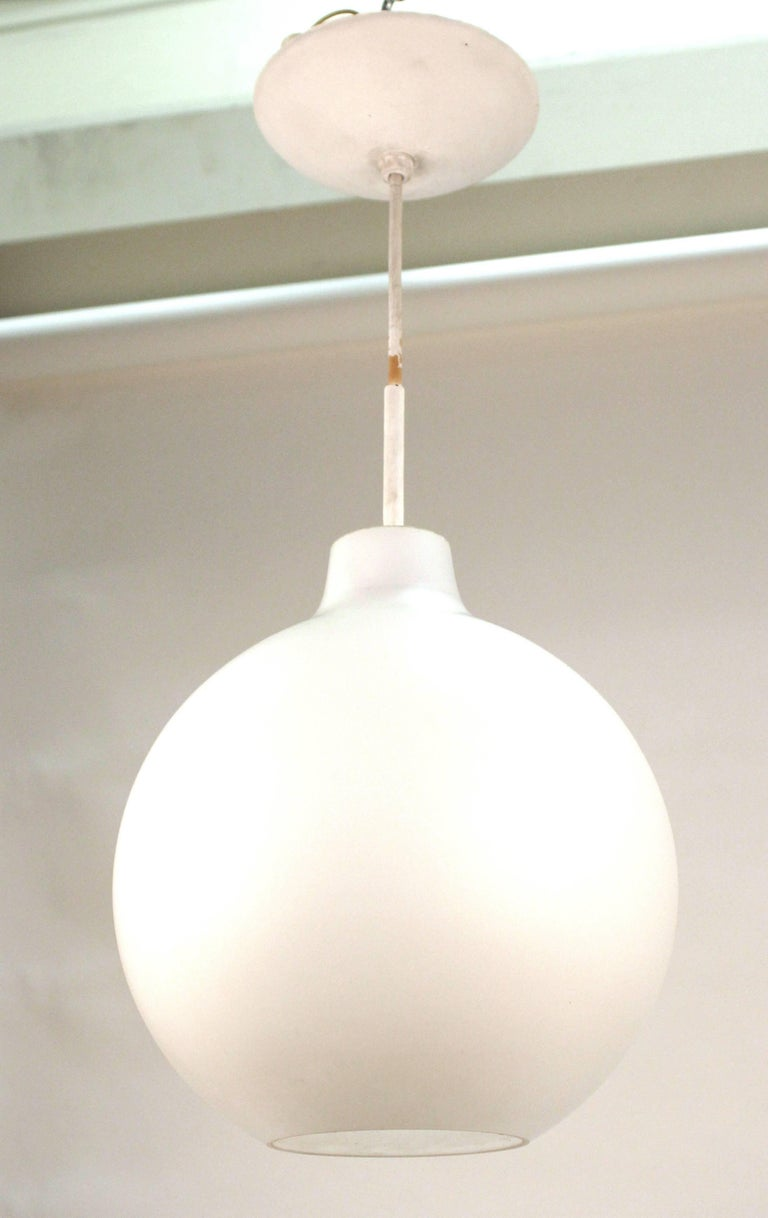 An organic spherical frosted glass pendant with white cord and canopy attributed to attributed to Stilux, circa 1960. Although there is some staining to the white cord and a few scuffs and marks to the pendant it is considered to be in good vintage