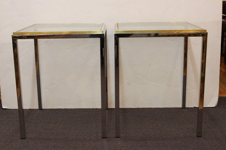 Pair of side tables attributed to Romeo Rega or Renato Zevi. The tables have square glass tops rimmed in brass. Manufactured in Italy during the 1970s, the side tables remain in good vintage condition with no pitting to chrome and minor scuffs.