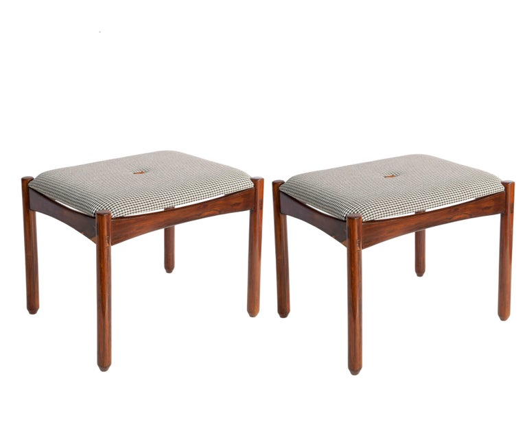 Brazilian Mid-Century Modern Michel Arnoult stools featuring checkered linen seats and jacaranda wood bases. The legs are of turned wood. These stools are in good vintage condition, consistent with age and use. The cushions have been recently