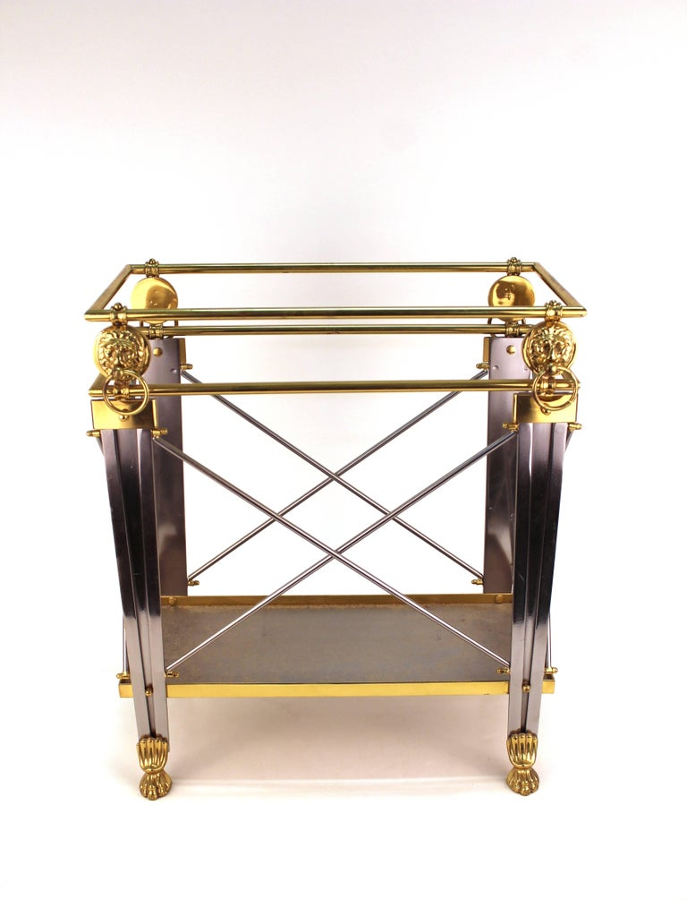 A Mid-century magazine holder in brass and metal, with lion heads and feet, made during the 1950's in Italy. Makers mark on the bottom. The piece is in excellent vintage condition.