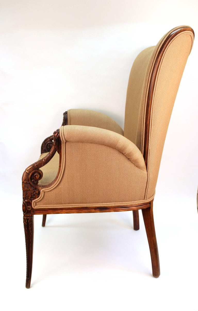A pair of butterfly armchairs in neoclassical style, made in the 1940s by Grosfeld House with a hand-sculpted wooden structure with rich detailing. In great vintage condition, recently reupholstered.