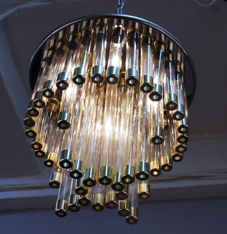A Mid-Century Modern chandelier with chrome structure on a circular base with chrome and glass tube pendants. The piece is in good vintage condition and has been rewired to US standards.